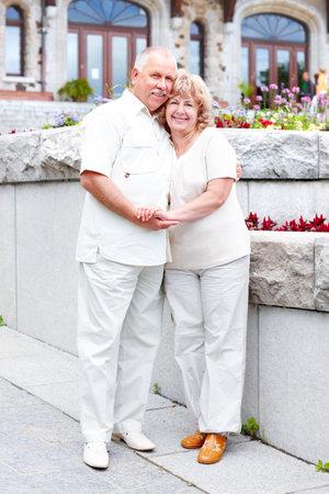 Smiling happy elderly senior  couple in the city  photo