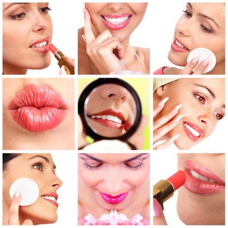 woman mirror: Pretty woman applying make up. Close up