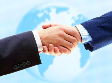 Zaken mensen. Handshake van zaken man. Over de blauwe achtergrond Stockfoto