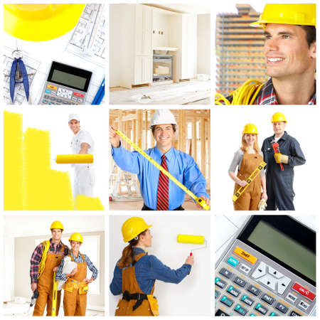 paints: Smiling builders workers. Painter, contractor, architect Stock Photo