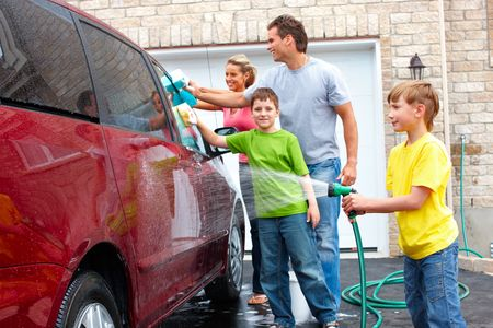 Smiling happy family washing the family car Stock Photo - 7088142