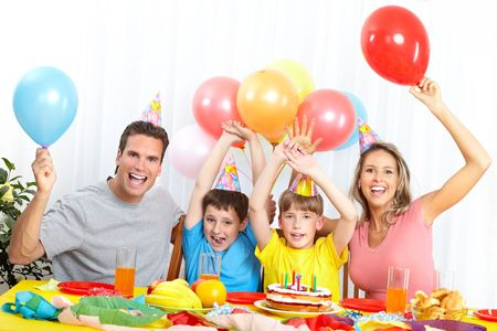 Happy family . Father, mother and children celebrating birthday at home