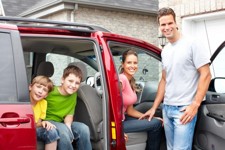 Smiling happy family and a family car  photo