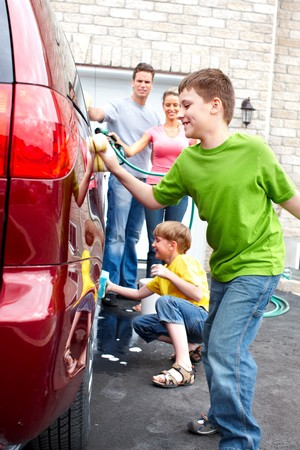 Smiling happy family washing the family car Stock Photo - 7088258