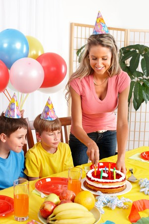 Happy family . Father, mother and children celebrating birthday at home Stock Photo - 7088189