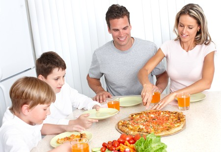 Family pizza . Father, mother and children eating a big pizza Standard-Bild