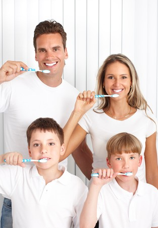 Happy family. Father, mother and children with toothbrushes.   photo