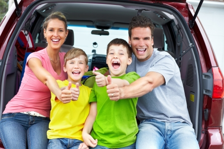 Smiling happy family and a family car Stock Photo - 7088269