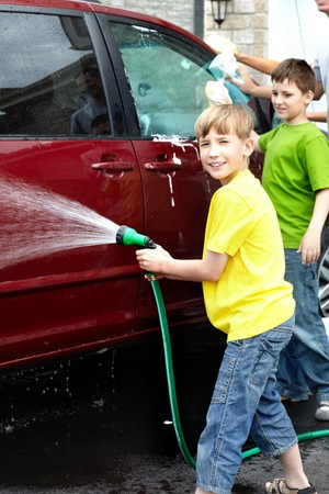 Smiling happy family washing the family car Stock Photo - 7088147