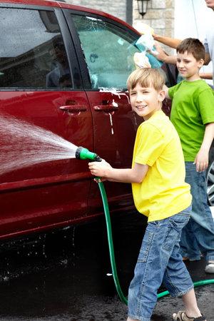 Smiling happy family washing the family car Stock Photo - 7088147