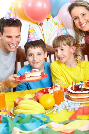 home party: Happy family . Father, mother and children celebrating birthday at home Stock Photo