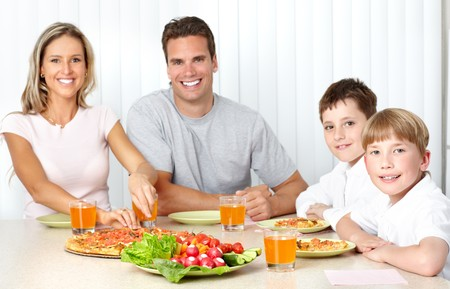 Family pizza . Father, mother and children eating a big pizza Stock Photo