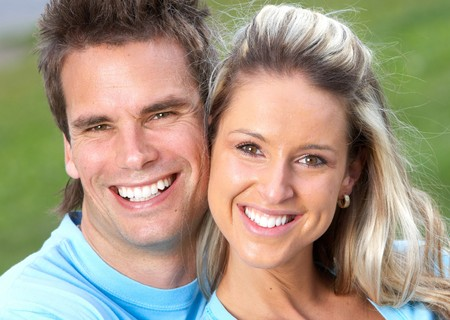 Young smiling  love couple outdoor