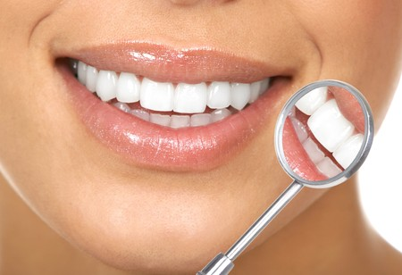 Healthy woman teeth and a dentist mouth mirror Stock Photo - 7169706