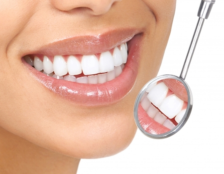 Healthy woman teeth and a dentist mouth mirror  Stok Fotoğraf