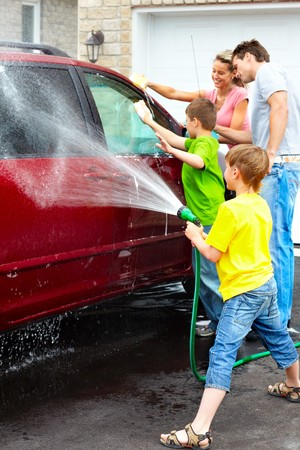 car wash: Smiling happy family washing the family car