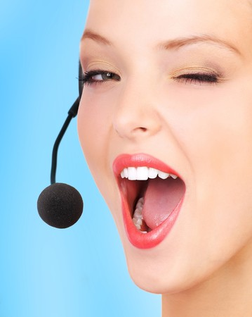 Beautiful  call center operator with headset. Isolated over white background Stock Photo - 7239344