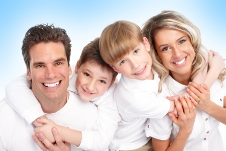 Happy family. Father, mother and children. Over blue background photo