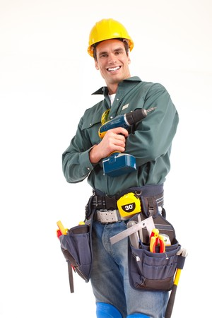 Handsome man with cordless hand drill. Isolated over white background photo
