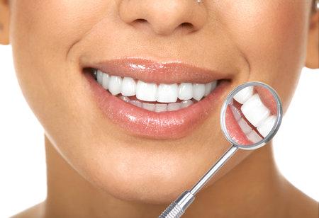 woman mirror: Healthy woman teeth and a dentist mouth mirror