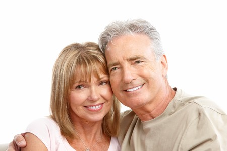 Happy seniors couple in love. Healthy teeth. Isolated over white background Stock Photo - 7231972