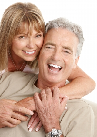 Happy seniors couple in love. Healthy teeth. Isolated over white background Stock Photo - 7231984