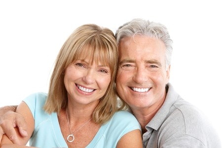 Happy seniors couple in love. Healthy teeth. Isolated over white background Stock Photo - 7231978