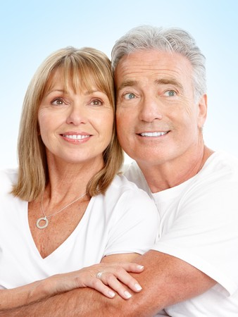 Happy seniors couple in love. Over blue background Stock Photo - 7231971