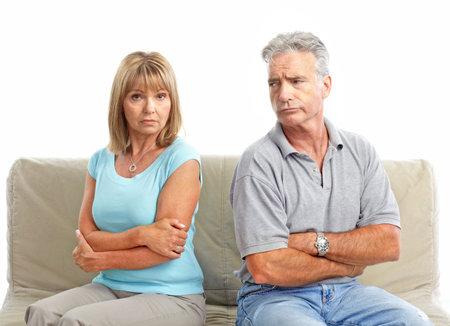 Sad elderly couple. Divorce. Isolated over white background