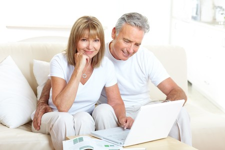 Seniors couple  working with laptop at home Stock Photo - 7231952