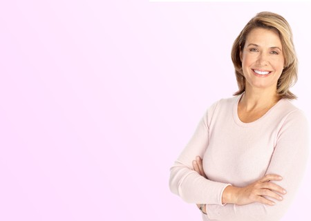 Smiling happy mature woman. Over pink background