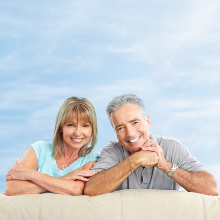 Happy smiling elderly seniors couple under blue sky  photo