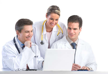 Smiling medical doctors working with a laptop computer. Isolated over white background