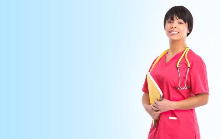 Smiling medical nurse with stethoscope. Over blue background  photo