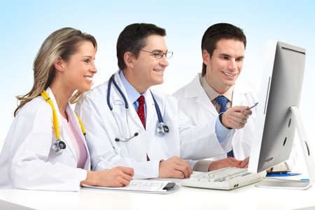 Smiling medical doctors with stethoscopes working with computer. Stock Photo - 7317204