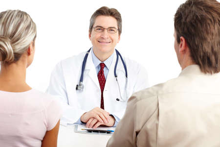 Medical doctor and young couple patients. Isolated over white background  photo