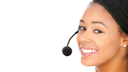 Beautiful  call center operator with headset. Isolated over white background  Stock Photo - 7317257