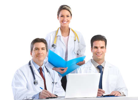Smiling medical doctors working with a laptop computer. Isolated over white background  photo