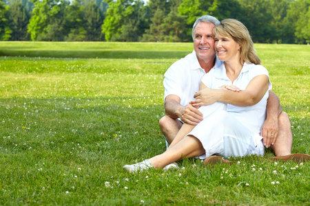 happy  elderly seniors couple in park Stock Photo - 7362799