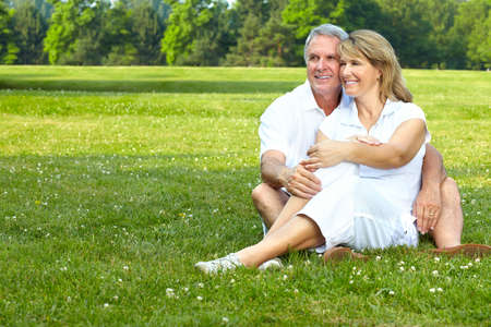 an old couple: happy  elderly seniors couple in park  Stock Photo