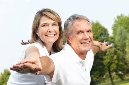 Happy elderly seniors couple in park  Stock Photo