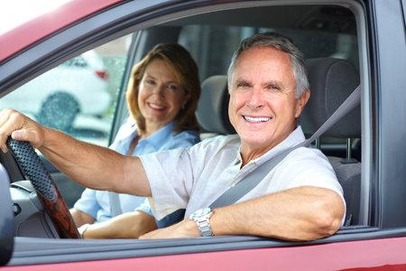 happy retirement: Smiling happy elderly couple in the car