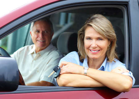 Smiling happy elderly couple in the car  photo