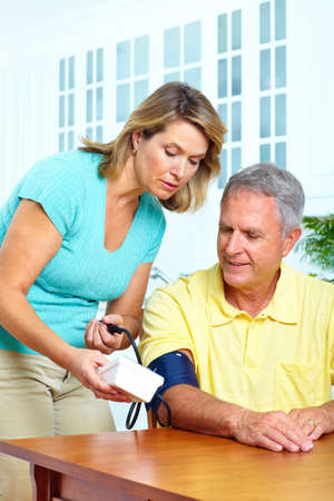 pressure: Seniors couple at home measuring blood pressure. Home monitoring  Stock Photo