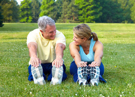 Happy elderly seniors couple working out in park Stock Photo - 7363023