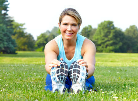 woman working out: Mature woman  working out in park. Fitness
