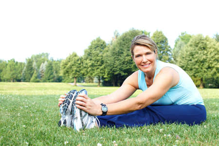 Mature woman  working out in park Stock Photo - 7365023