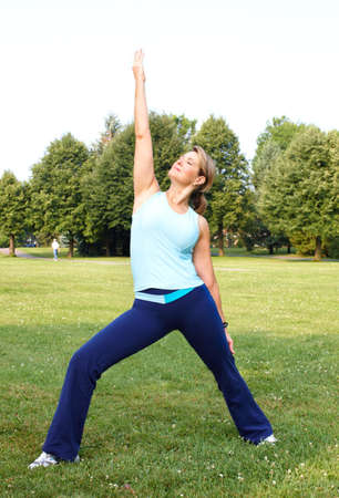Mature woman  working out in park