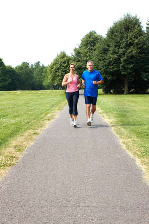 Happy elderly seniors couple jogging in park Stock Photo - 7365065