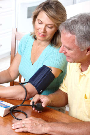 Seniors couple at home measuring blood pressure. Home monitoring  Stock Photo